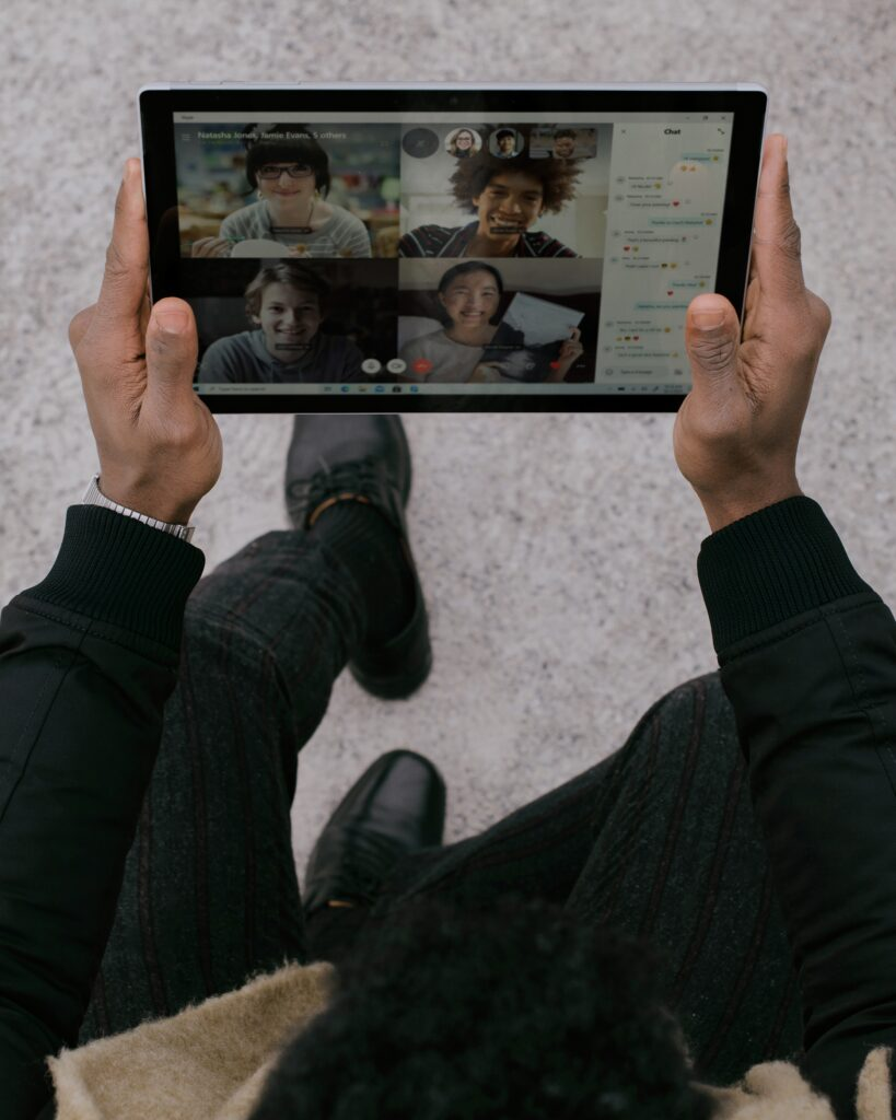 person holding black tablet Surface